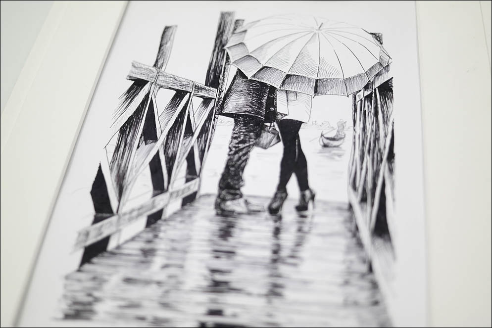 Lovers under umbrella on rainy day in Venice. Lenskiy.org